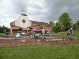 Peace Lutheran gardeners at work on their plots.